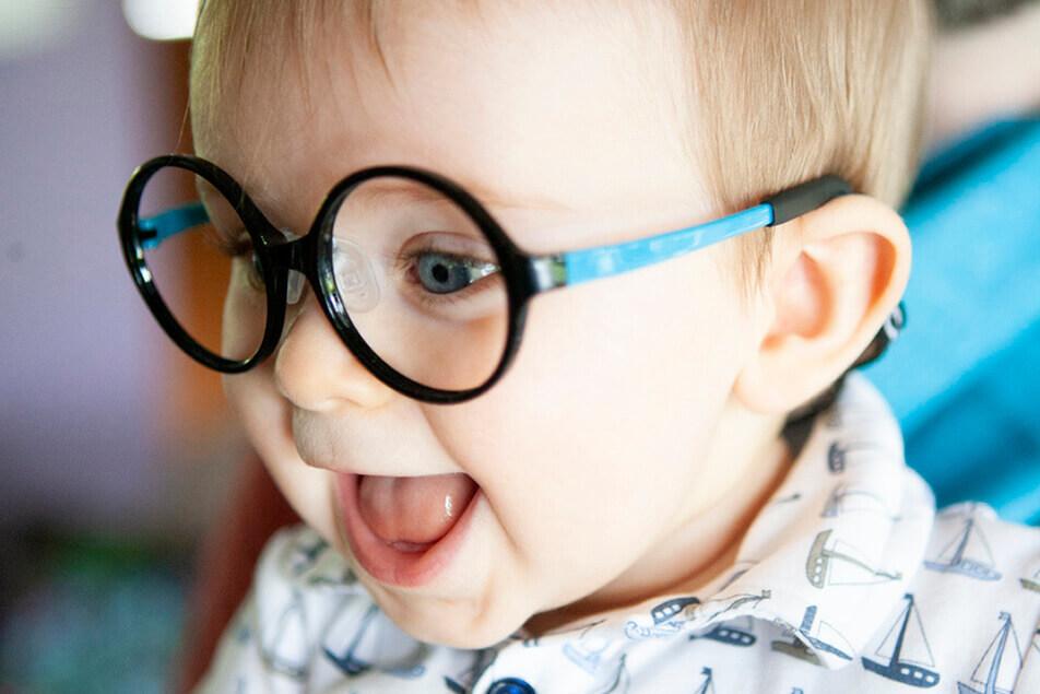 Baby Model wearing Cascadia Eye eyeglass frames
