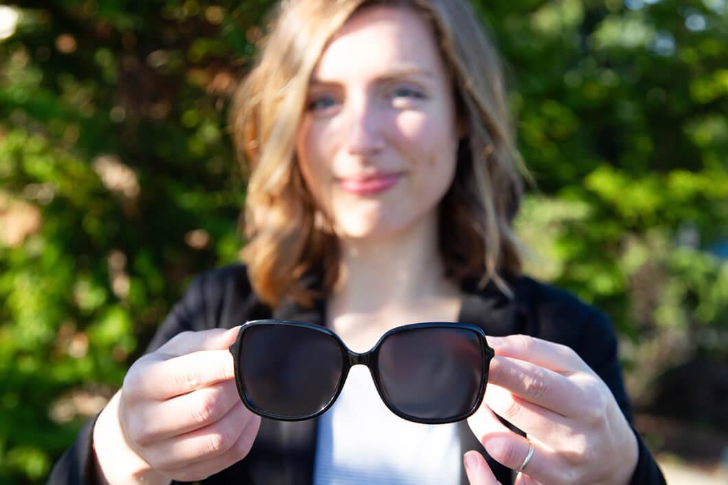 Woman holding Sun Glasses