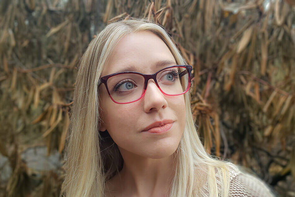Blonde woman in pink glasses
