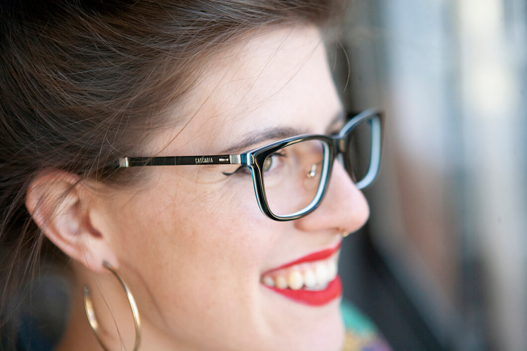 Smiling woman close up with blue designer eyewear