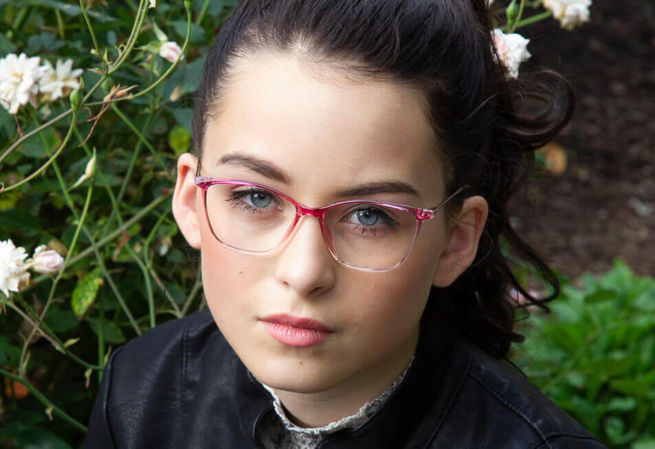 Edgy woman in red glasses