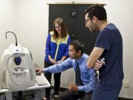 Eye doctors looking at OCT machine