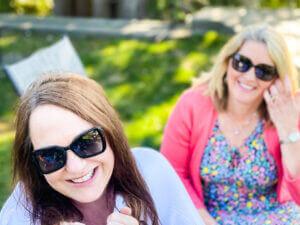 Women outside wearing sunglasses on sunny day