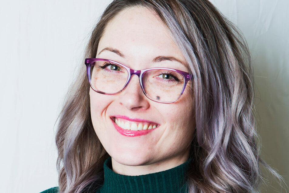 Young woman in purple glasses