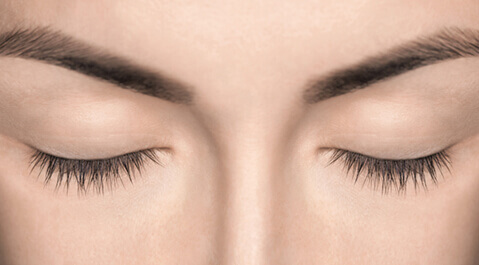 Close up of woman's closed eyelids