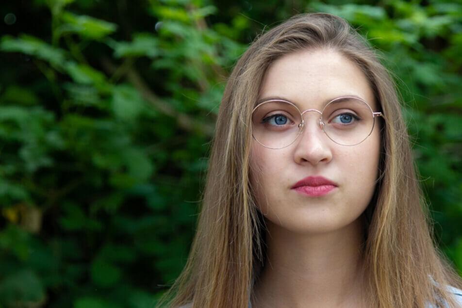 Model wearing Cascadia Eye eyeglass frames