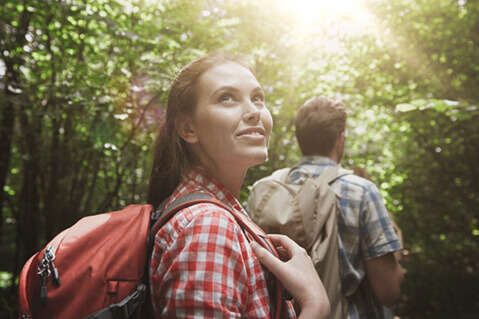 Woman hiking in the woods